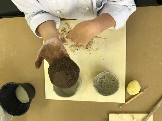 My students getting familiar with the clay
