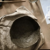 a bowl in black clay